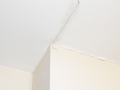 vertical cracks, wall cracks, bowed ceiling